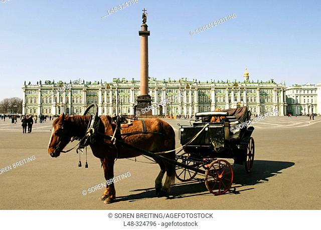 Winter Palace with The Hermitage Museum, St. Petersburg, Russia, and Aleksander column at Dvortsovaya Ploshchad or Palace Square with horse and carriage in...
