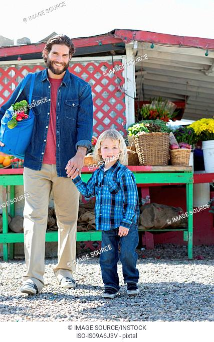 Father and son at farmer?s market