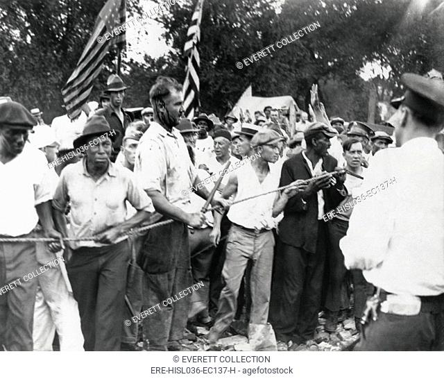 Bonus Marchers confront Washington, D.C. police, July 28, 1932. Veterans pushing the line forward in their battle, one with blood streaming down his face