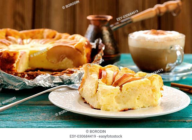 Syrnik, quark pie with apples served with Vienna coffee on old wooden table horizontal