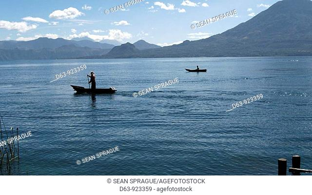Guatemala. Lake Atitlan, from San Marcus La Laguna. Fishermen in canoes