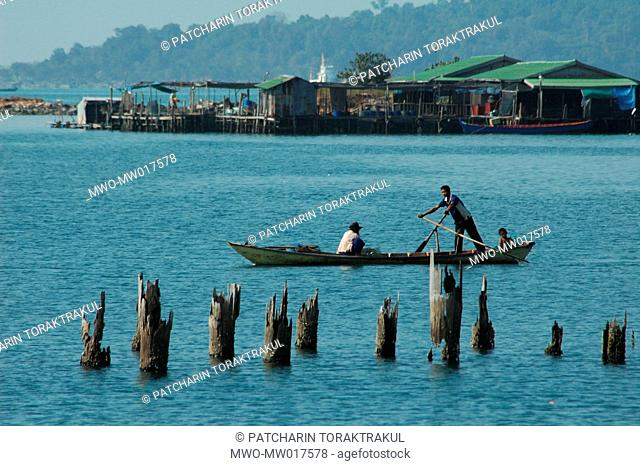 """Fishermen steers out to fish in the small gulf known to the locals as """"Pigeon Island,"""" which remains calm, quiet, and abundant because it is yet to be..."""