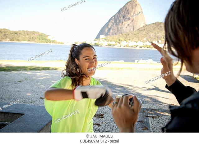 Female boxer training with personal trainer, Rio De Janeiro, Brazil
