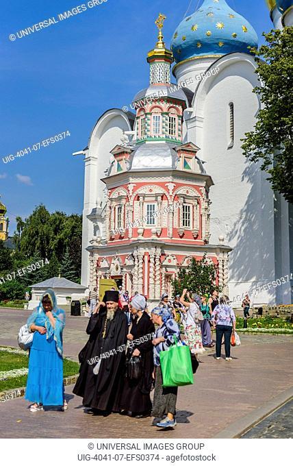 Orthodox patriarch talking to Russian women, Trinity Sergiev Monastery, Russia