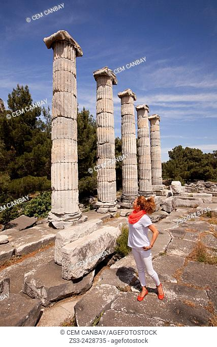 Tourist at the Temple of Athena at the ancient city of Priene, Soke, Aydin, Turkey, Europe