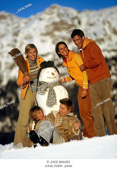 View of a family building a snowman