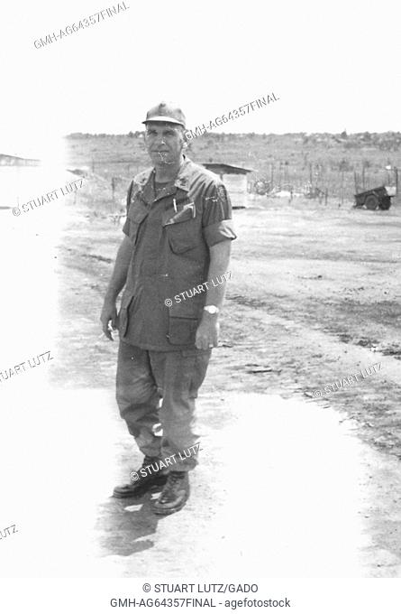 American servicemen Raymond Bergeson standing in military uniform in an airfield in Vietnam during the Vietnam War, a member of Team 3, 1964