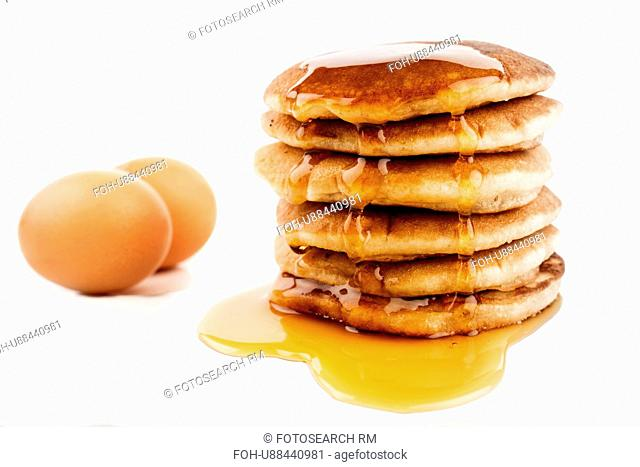 Stack Of Pancakes With Maple Syrup And Fresh Egg