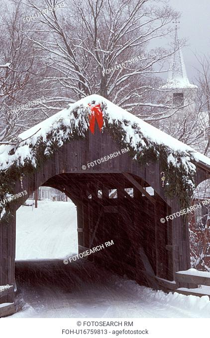 Vermont, covered bridge, The snow covered Village or Church Street Covered Bridge, circa 1877, is decorated for the Christmas holidays with greens and a red bow