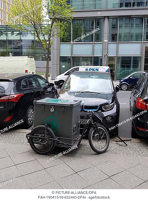 12 April 2019, Berlin: An e-car of a rental company is charged at a mobile charging station of the Berlin company Chargery