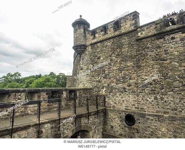 Edinburgh Castle is a historic fortress which dominates the skyline of the city of Edinburgh, Scotland, from its position on the Castle Rock