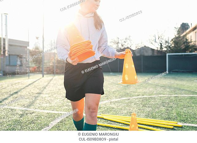 Football player preparing pitch for practice