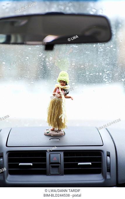 Hula statue on car dashboard