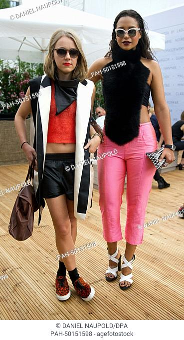 Fashion Week visitors Dana Roski (L) and Joyce Binneboese pose for photos at the Mercedes-Benz Fashion Week in Berlin, Germany, 10 July 2014