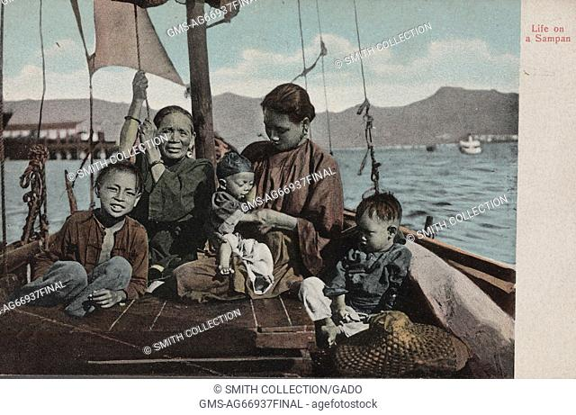 Hand colored postcard marked Life on a Sampan, showing a Chinese family on a boat with three young children, the youngest being breastfed by his mother