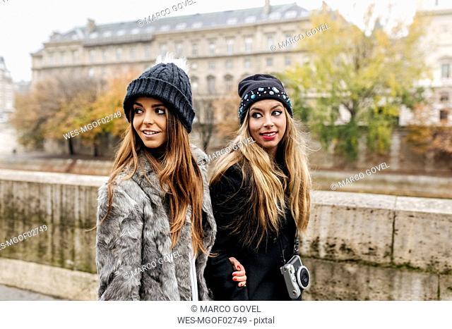 Paris, France, two women strolling near Seine River