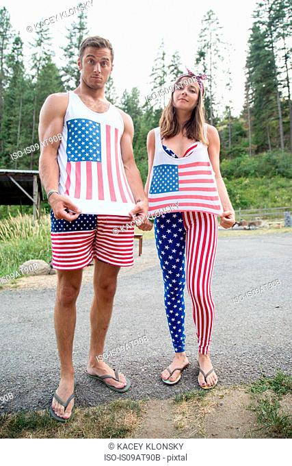Portrait of couple showing off American flag costume celebrating Independence Day, USA