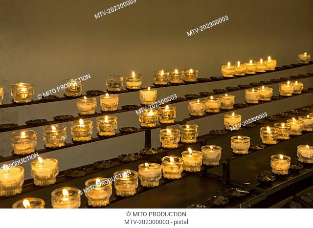 Burning candles in church, Carinthia, Austria