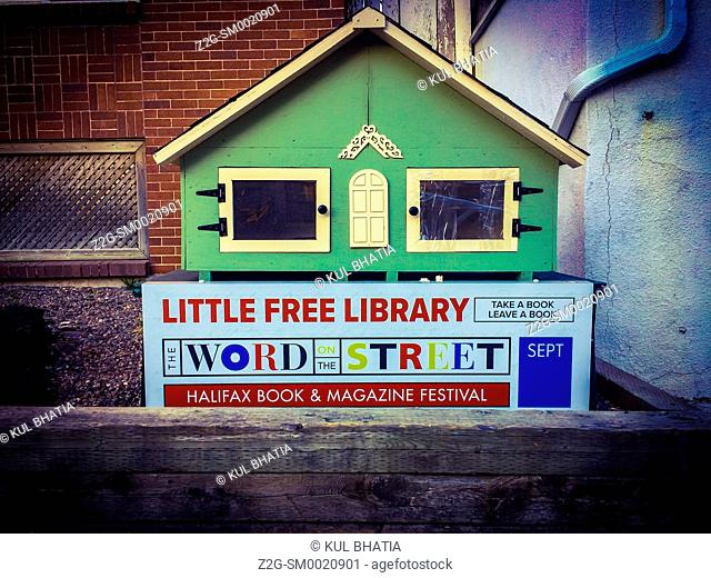 Little free library, downtown, Halifax, Nova Scotia's capital city, Canada. People are enjoined to 'take a book or leave a book