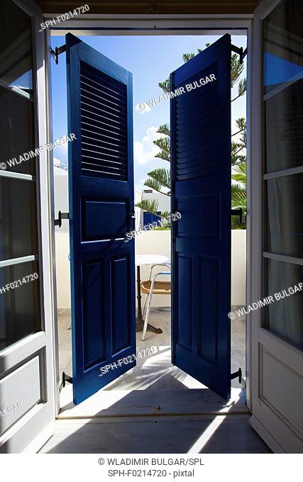Shuttered doors onto balcony
