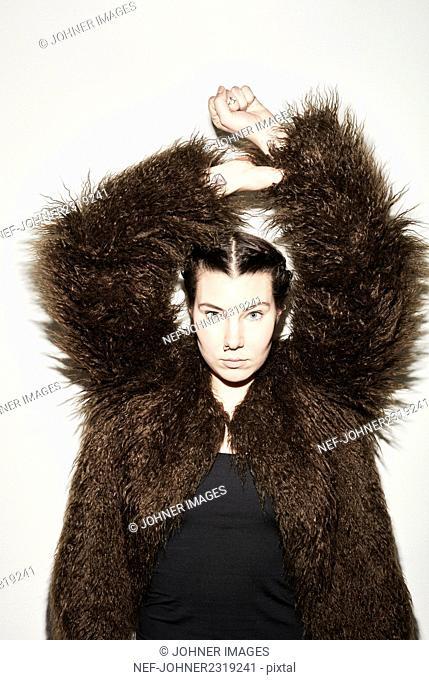 Young woman wearing faux fur