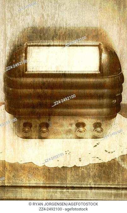 Watermarked and aged image of a antique radio sitting on standard 1950s styled bench. Weathered wireless