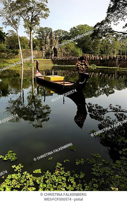 Cambodia, boat on lake at temple at Angkor Thom