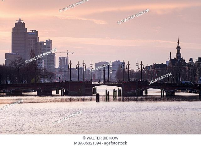 Netherlands, Amsterdam, dawn view of the Omval commercial district from the Amstel River