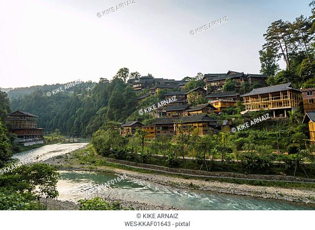 China, Guizhou, Miao settlement at the riverside