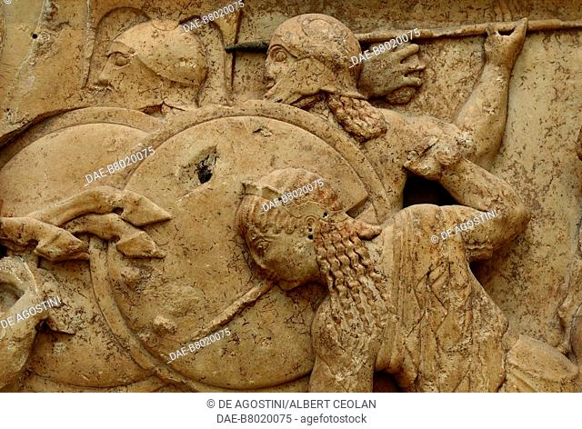 Two giants and Hera, detail of the Gigantomachy, relief, north frieze of the Siphnian Treasury, 530-525 BC, from Delphi, Greece