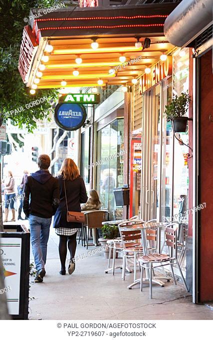 San Francisco, California: Couple walking arm in arm along Columbus Avenue in North Beach