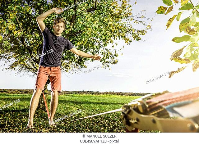 Portrait of young man balanced on slackline