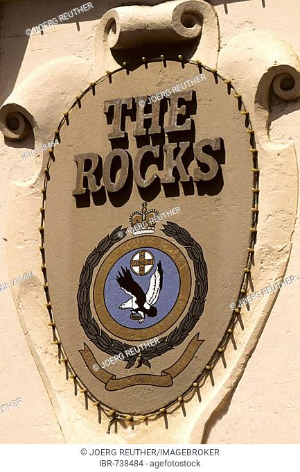 Sign on a building facade marking The Rocks district, oldest part of Sydney, New South Wales, Australia