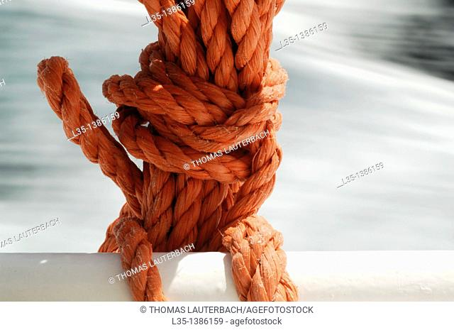 Sailor knot with violent waves in the background