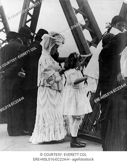 Jews praying on the Williamsburg Bridge on Yom Kippur, the Jewish New Year. Ca. 1909