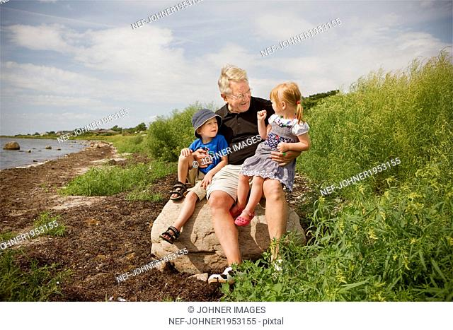 Grandfather with grandchildren, Sweden