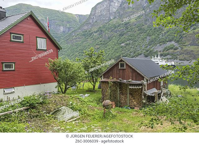 house and rural idyll at the seashore of Undredal, Norway, ferry of the Sognefjorden