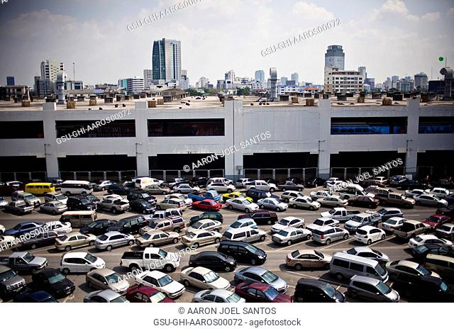 Parked Cars at Train Station With Skyline in Background, Bangkok, Thailand, Asia