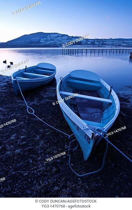 Row boats on shore at Llangorse lake, Llangors, Brecon Beacons national park, Wales