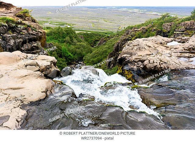 Iceland, Svinafellsjokulsvegur glacier, waterfall with a view of the surrounding countryside