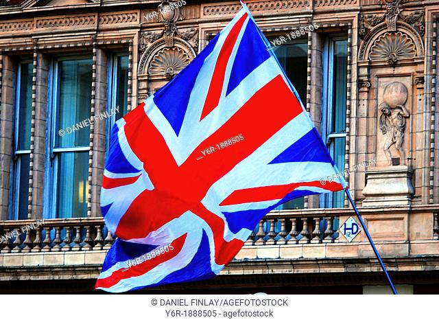 Union Jack flag seen at London, England, New Year's Day Parade as it passes down Pall Mall East, near Trafalgar Square
