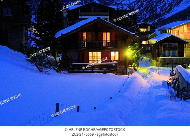 Traditional wooden chalets at night, Saas Fee, Alps, Swtzerland