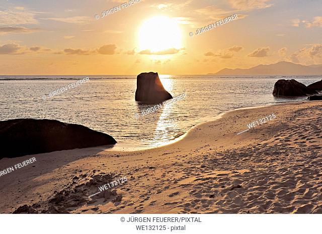 Sunset on the beach at Source d'Argent, La Digue, Seychelles