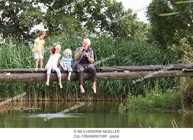 grandfather and children fishing