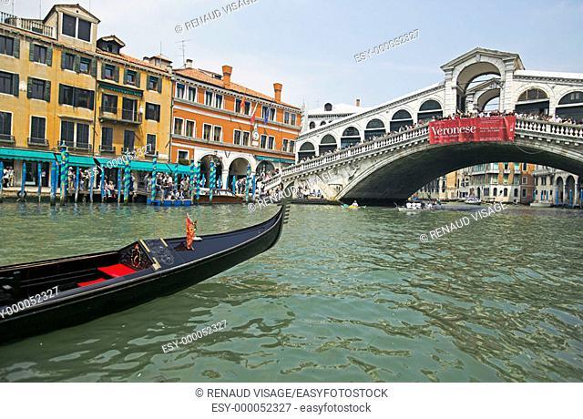 Gondola and the Rialto Bridge. Venice. Italy