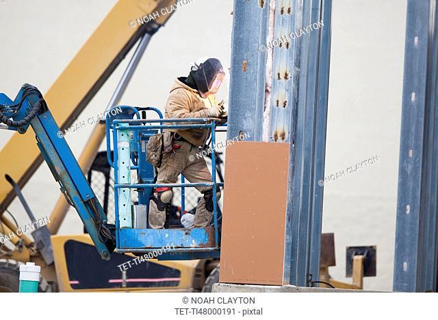 Men welding steel bar