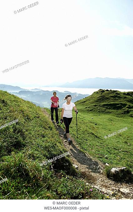 Austria, Two women Nordic walking at Kranzhorn