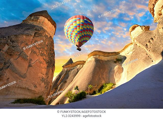 """Pictures & images of hot air balloons over the fairy chimney rock formations and rock pillars of """"Pasaba Valley"""" near Goreme, Cappadocia, Nevsehir, Turkey"""