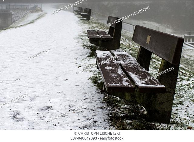 Bench empty seat in the wood trees winter and fog 7