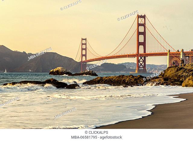 Golden Gate Bridge at sunset shot from Baker Beach, San Francisco, Marin County, California, USA